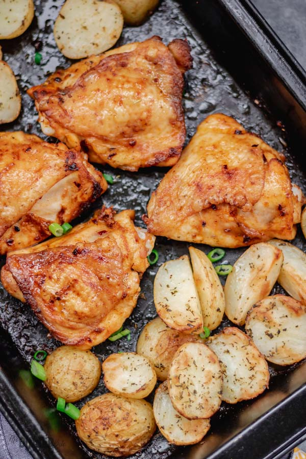 A close shot of one pan chicken and potatoes dinner.