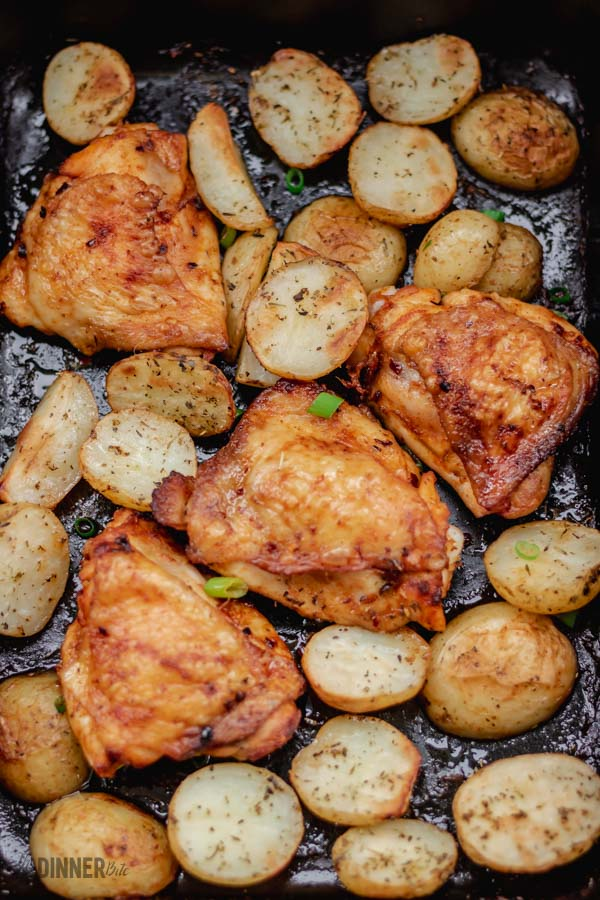 baked chicken and potatoes in one baking pan.