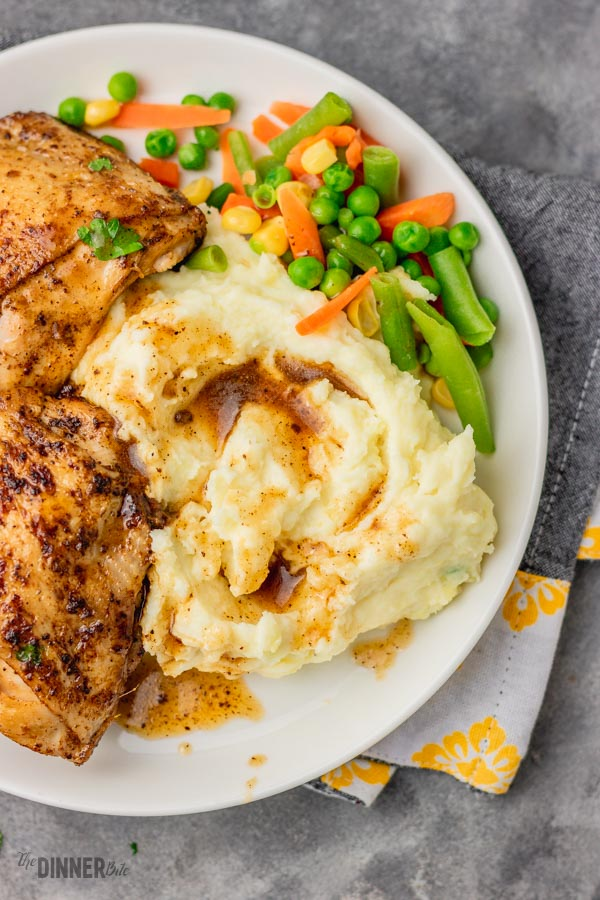 mashed potatoes served with stovetop chicken thighs, gravy and mixed veg.