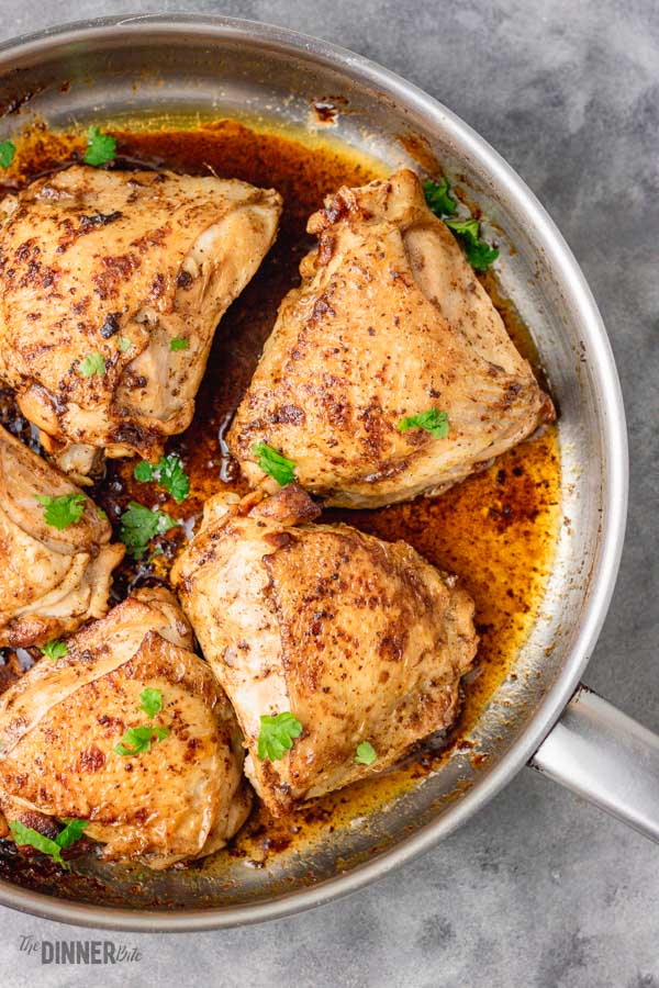 stove top chicken thighs in an iron skillet.