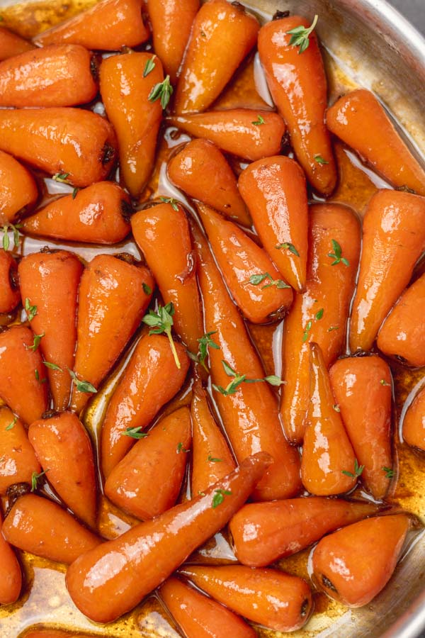 brown sugar glazed carrots in a skillet made on the stovetop.