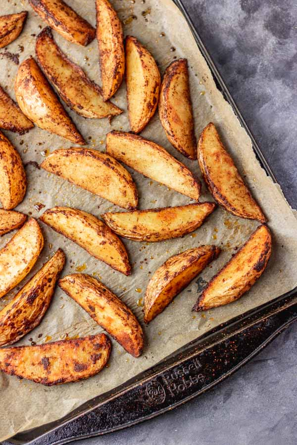 freshly baked crispy potato wedges out of the oven.