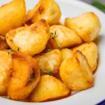 crunchy and fluffy perfect roast potatoes.