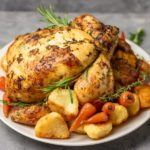 simple roast chicken with roasted potatoes and glazed carrots.