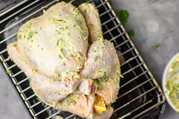 a whole 2 kg chicken rubbed with herb butter.