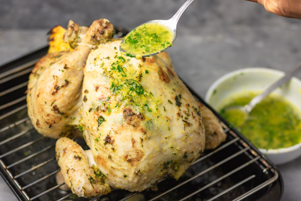 how to spoon herb butter on partially roasted chicken.