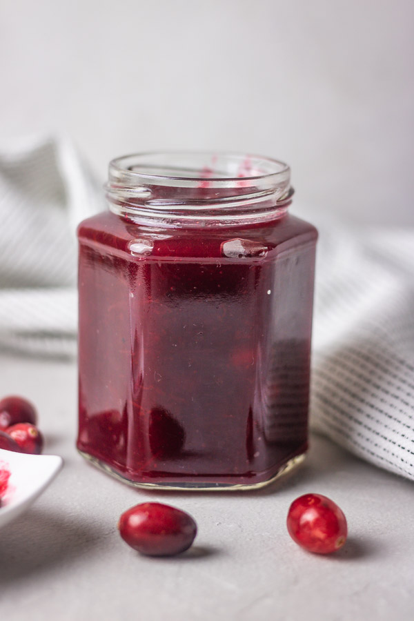 homemade instant pot cranberry sauce in a jar.