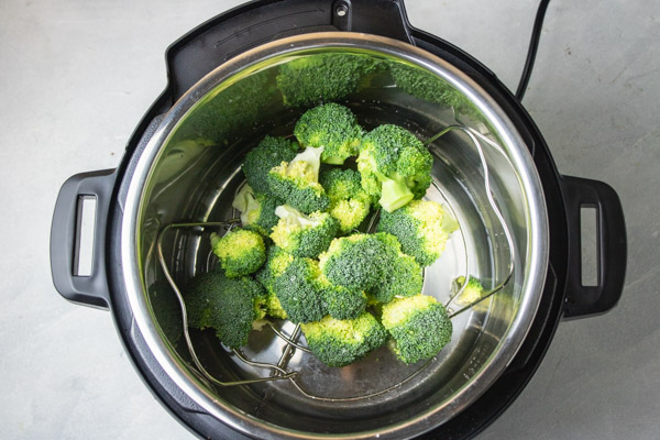 raw broccoli florets in an instant pot.