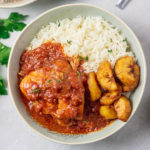instant pot chicken cacciatore served with rice and fried plantain in a bowl.