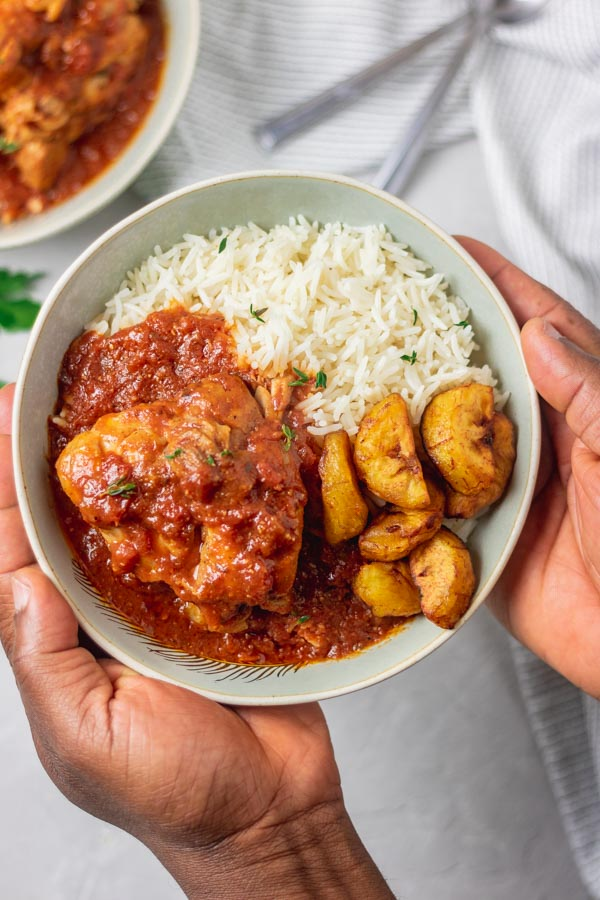 instant pot chicken cacciatore served in a bowl with basmati rice and fried plantain.