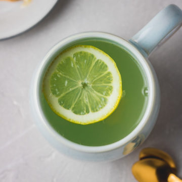 a cup of honey and lemon drink.