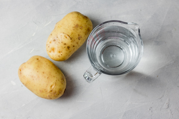 two large potatoes and a glass of water.