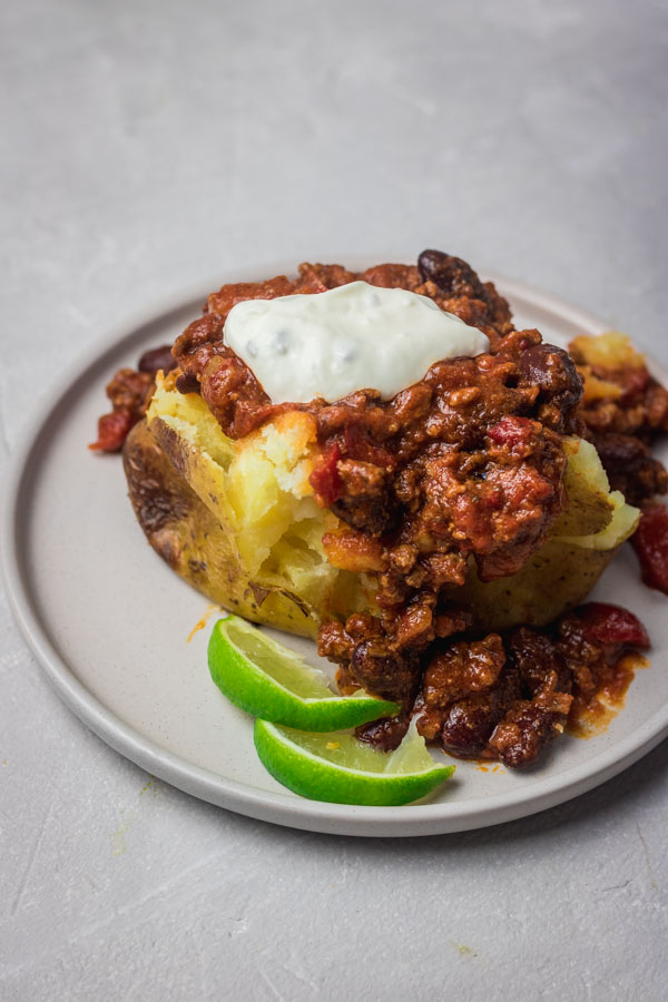 instant pot chili served over a jacket potato.