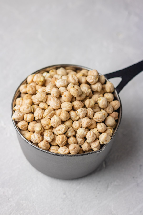 A cup of dried chickpeas.