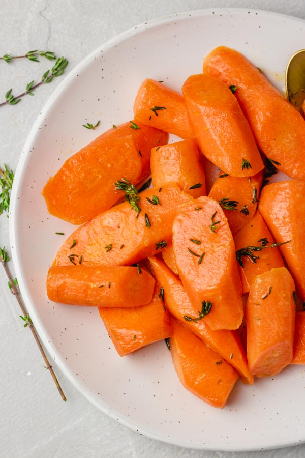 Instant pot steamed carrots garnished with thyme.
