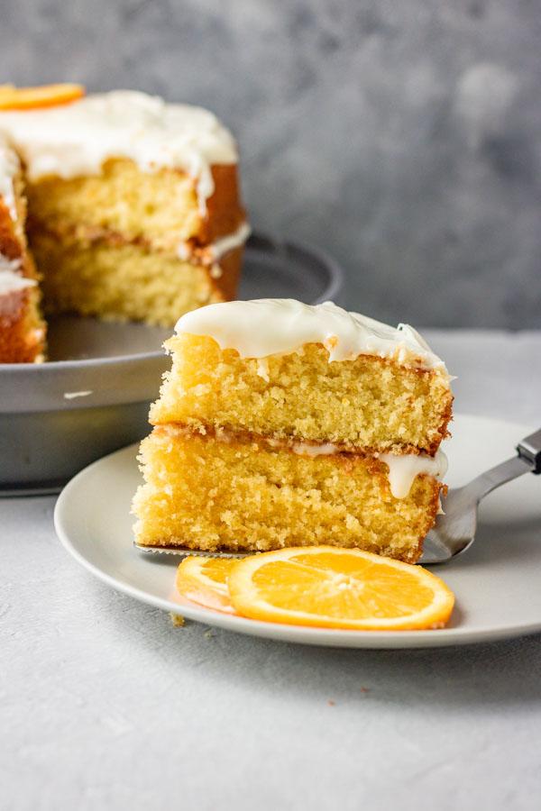 a slice of orange cake on a cake knife.