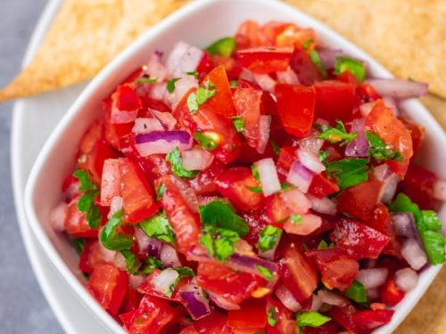 a small bowl of Salsa Fresco served with tortilla chips