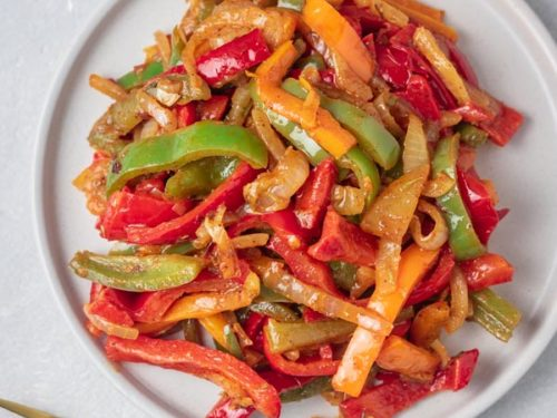 a plate of sauteed peppers and onions.
