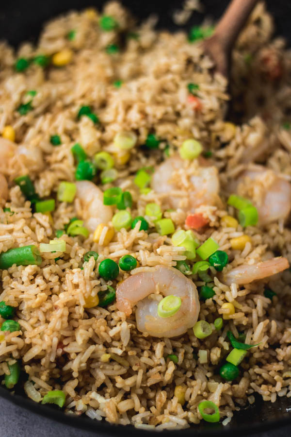 shrimp fried rice in a wok.