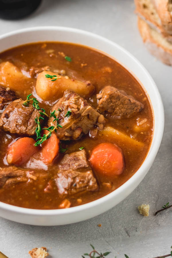 a bowl of instant pot pressure cooker beef and Guinness stew.