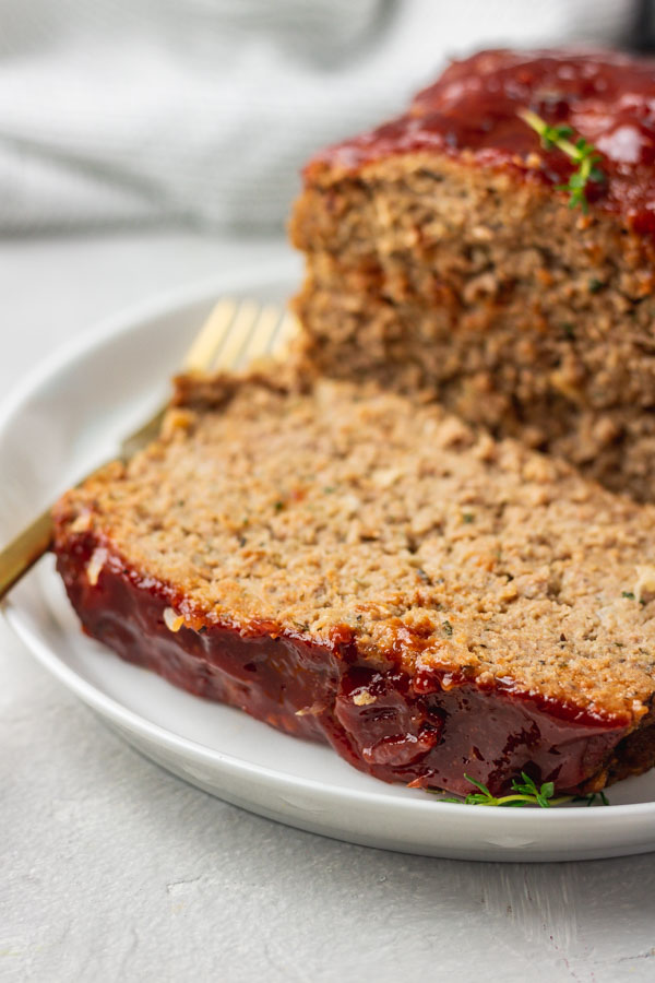 a slice of instant pot meatloaf on a plate.