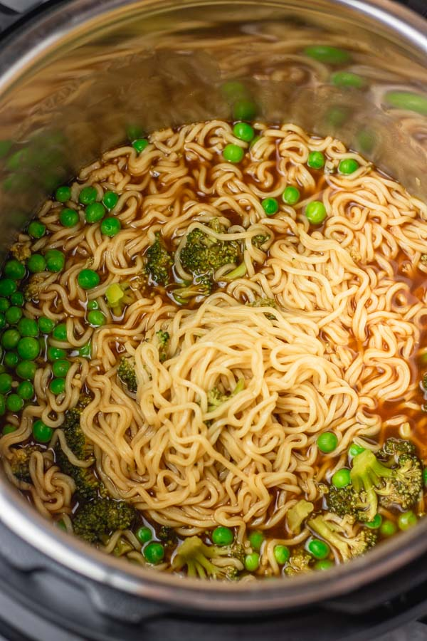 upgraded instant pot ramen noodles with peas and broccoli.