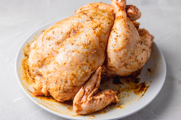 marinated chicken on a plate.