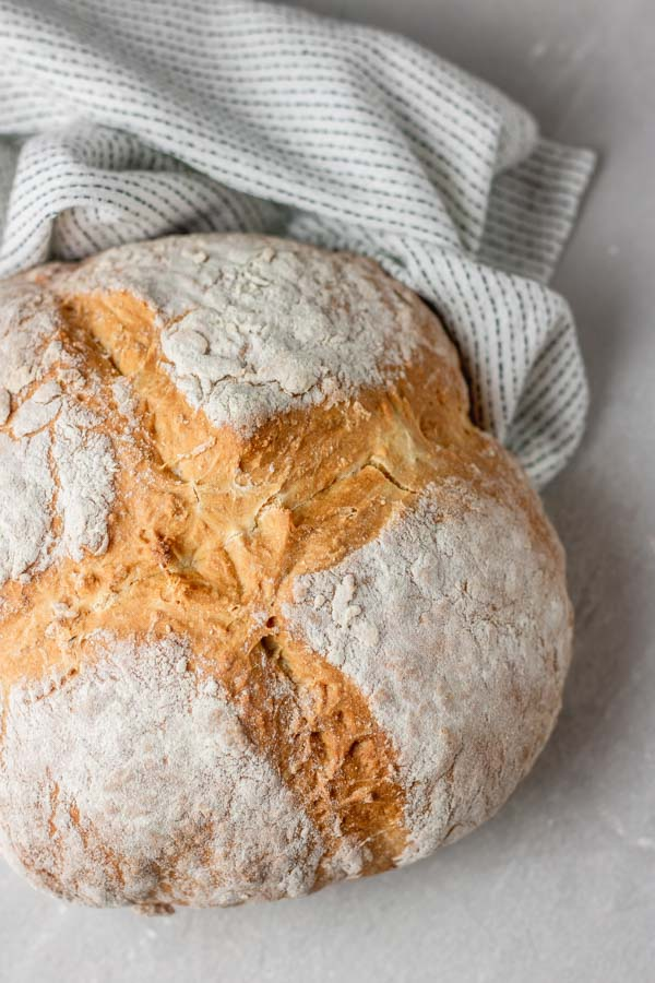 a loaf of freshly baked white soda bread.