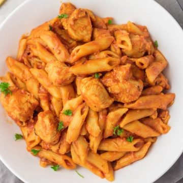 a bowl of chicken penne pasta.