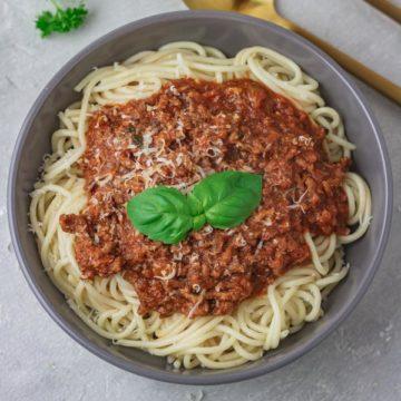instant pot bolognes sauce served over spaghetti.
