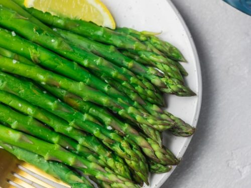a plate of steamed instant pot asparagus.