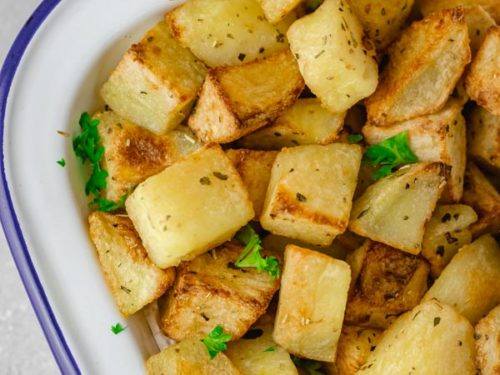 oven roasted parmentier potatoes in a white tin.
