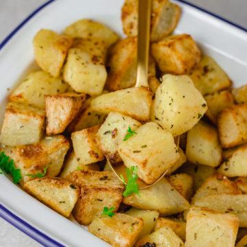 a bowl of parmetier cubed potatoes.