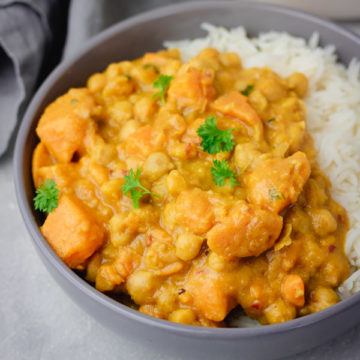 a bowl of sweet potato curry with chickpea.
