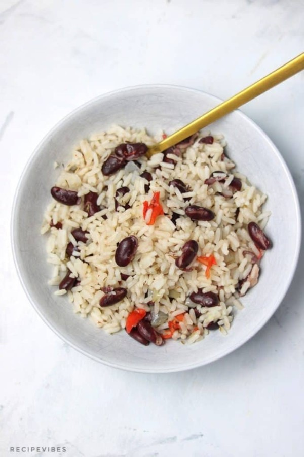 a white bowl containing boiled rice and red kidney beans.