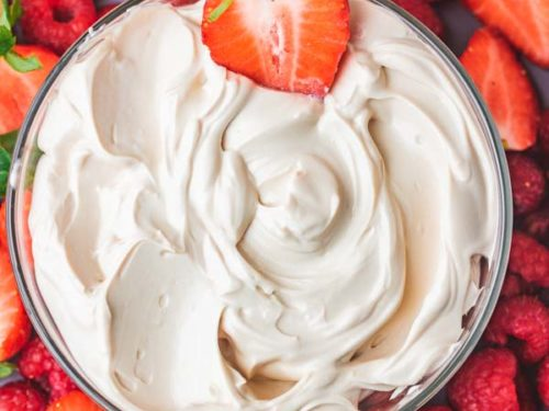 a platter of cream cheese fruit dip.