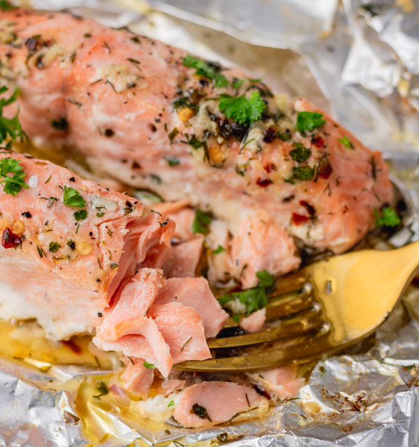 flaked baked salmon on a fork.