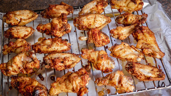 baked chicken wings on a baking rack.