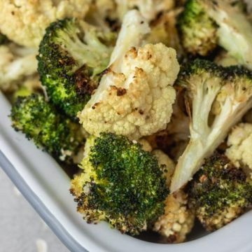 roasted cauliflower and broccoli in a baking dish.