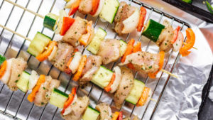 chicken skewers on a grilling rack.