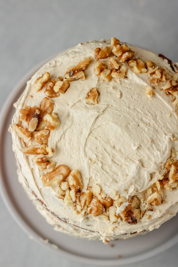 decorated coffee cake with chopped walnuts.