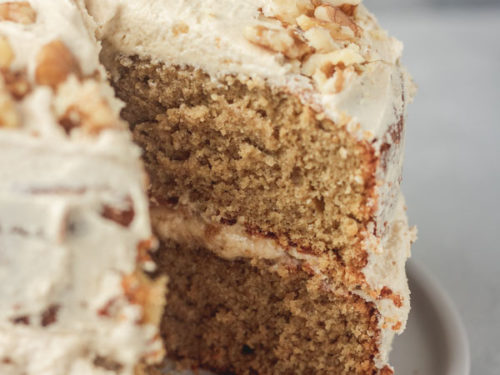 layered coffee cake with a slice cut out of it.