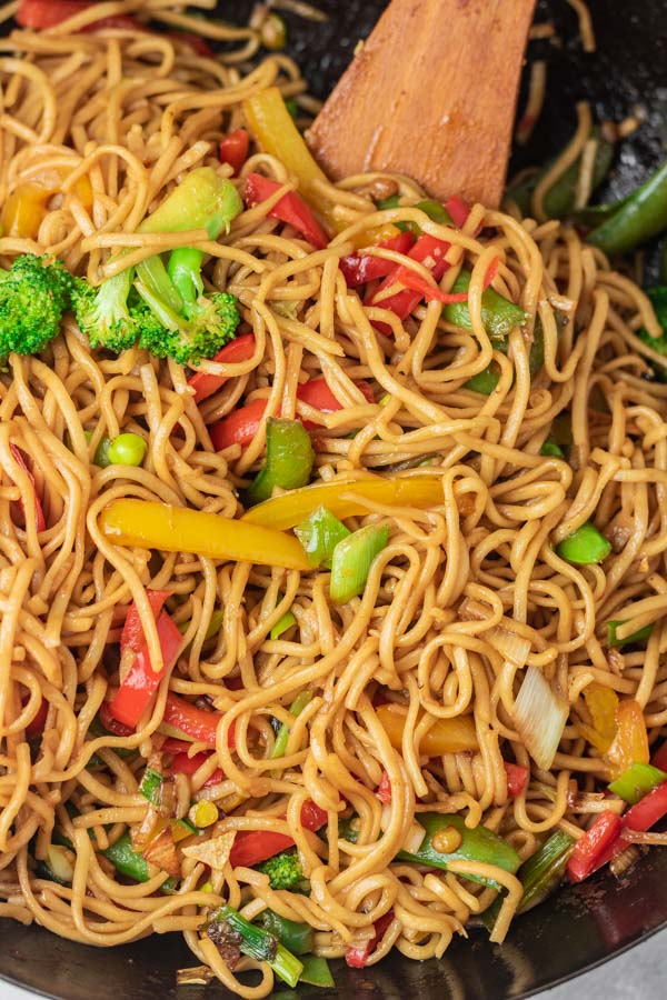 freshly made chow mein noodles in a wok.