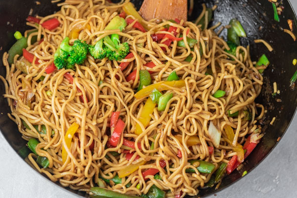 ready vegetable noodles in wok.