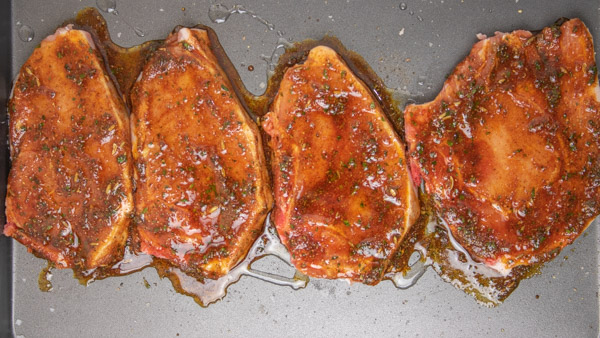 marinated meat in a baking tray.