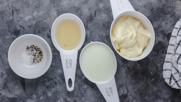 cup of mayonnaise, vinnegar, milk, salt and pepper.