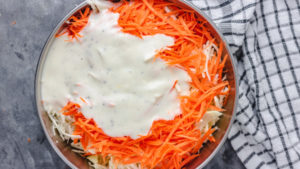 creamy dressing poured over salad.