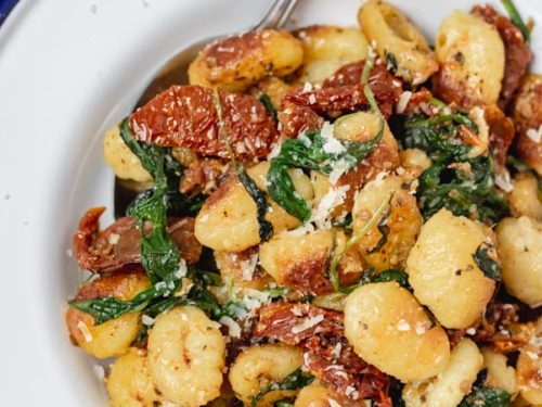 a plate of pan fried gnocchi.