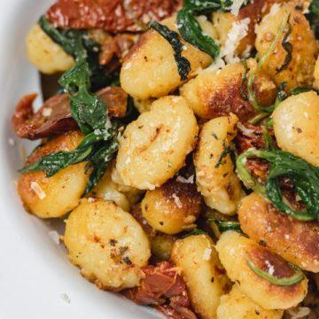 a bowl of pan fried gnocchi.