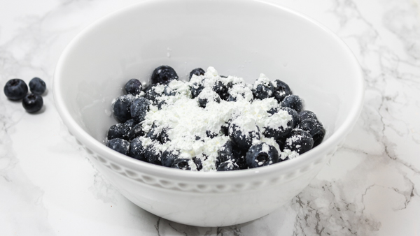 a white bowl of blueberries.